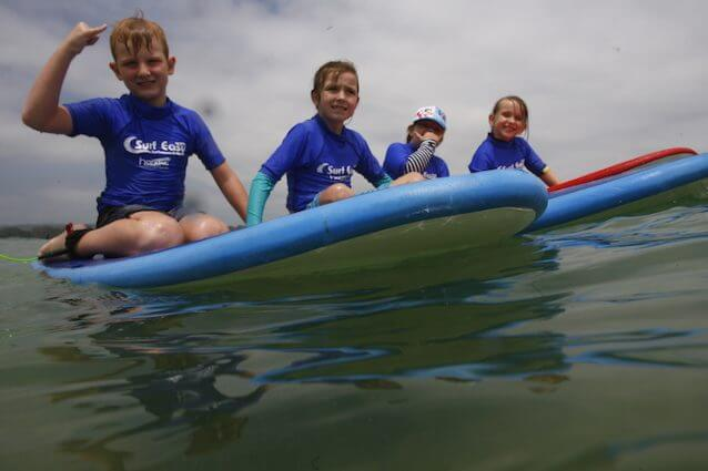 Learn to surf with surf easy surf school currumbin alley kids